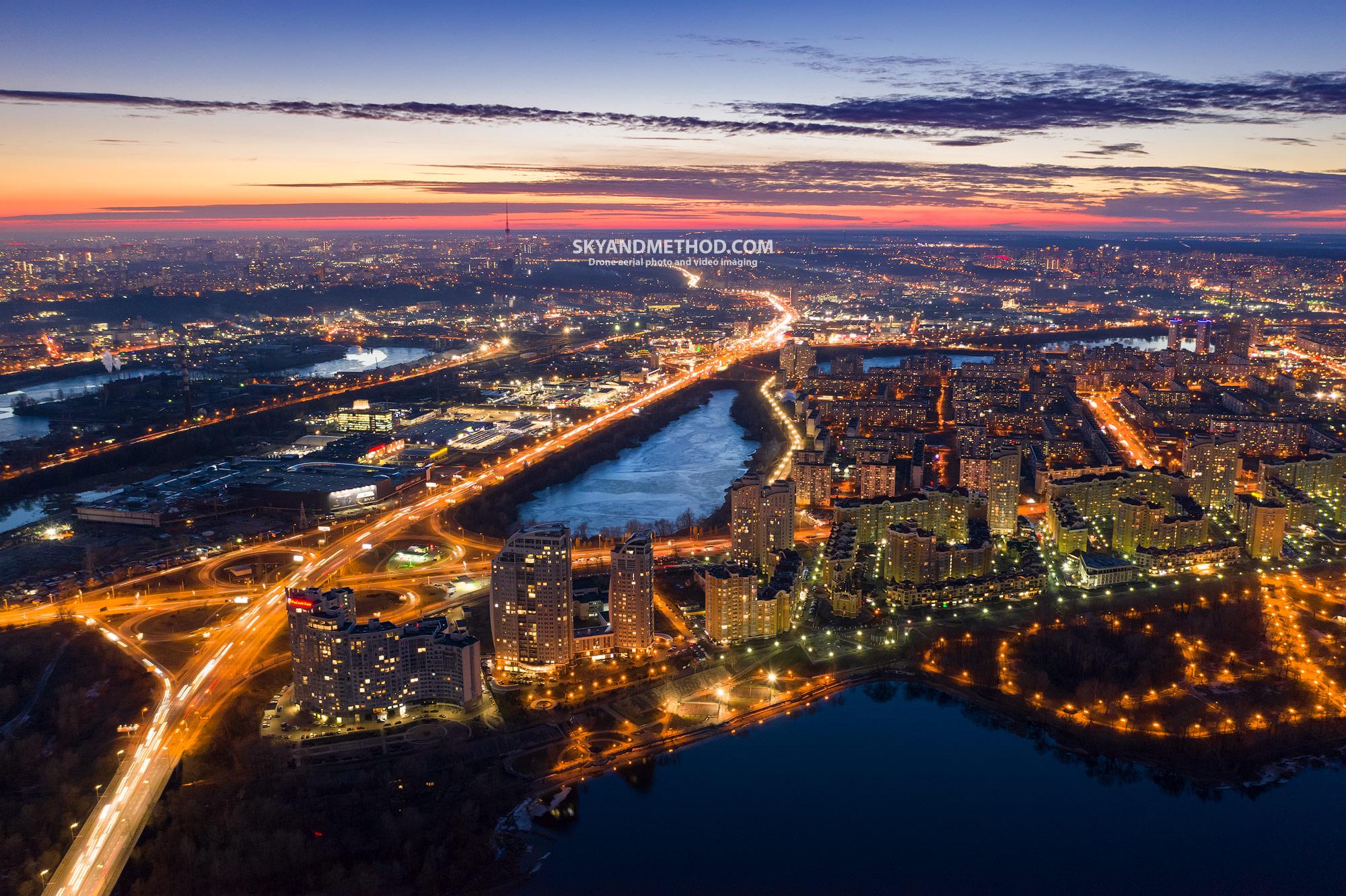Ночной Киев с высоты. Оболонь на закате